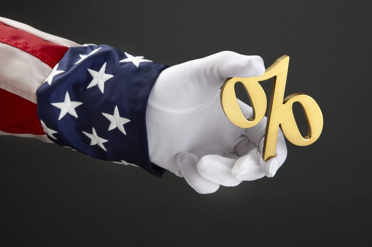 Uncle Sam holding a percent sign