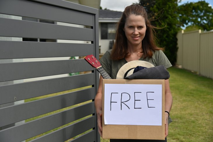 Woman holding a box of clutter to donate