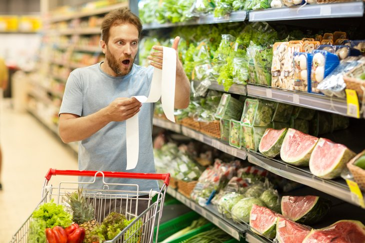 Shocked shopper looking at receipt