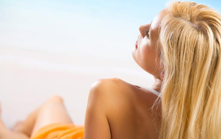 Blonde woman laying in sun