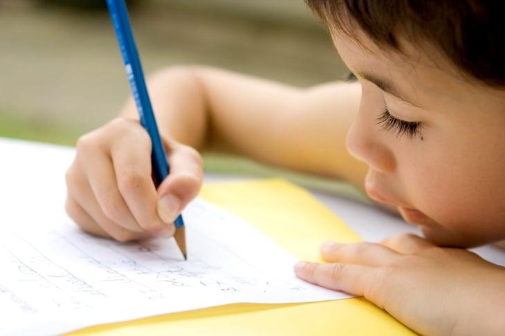 Boy writing letter
