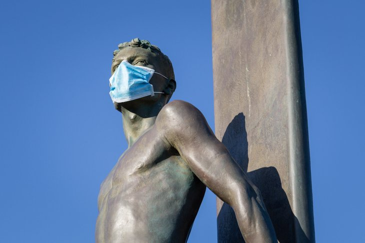 Surfer statue with mask in Santa Cruz, California