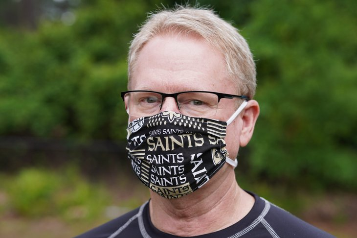 Man in a New Orleans Saints mask