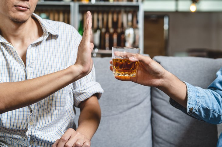 Man turning down an alcoholic drink
