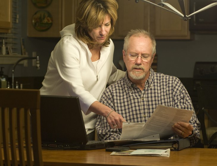Baby boomer couple looking at their finances