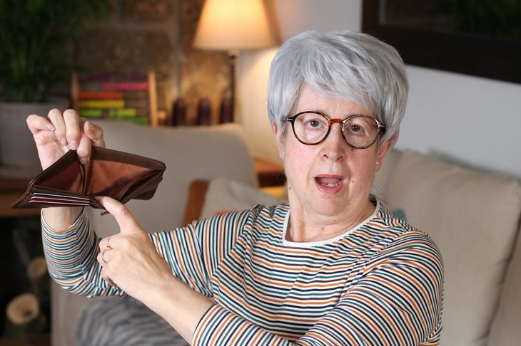 Older woman with empty wallet