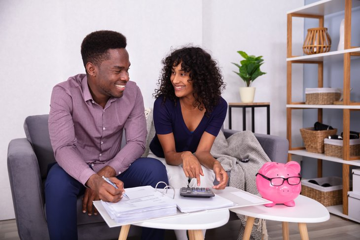 Young couple looking over their finances