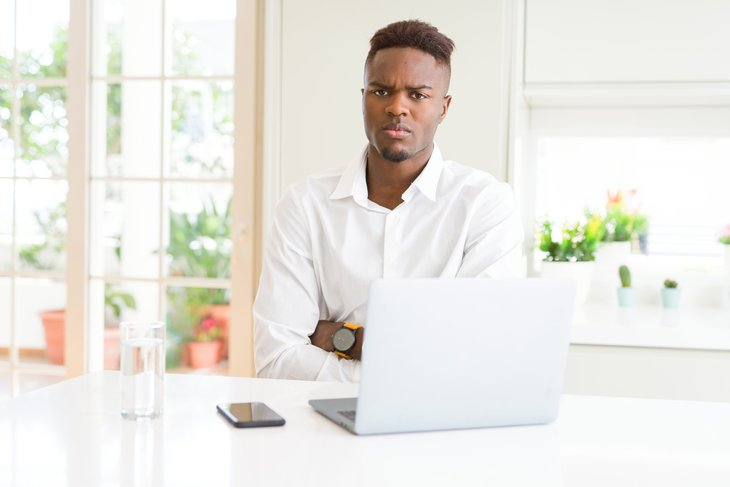 Unhappy man on laptop