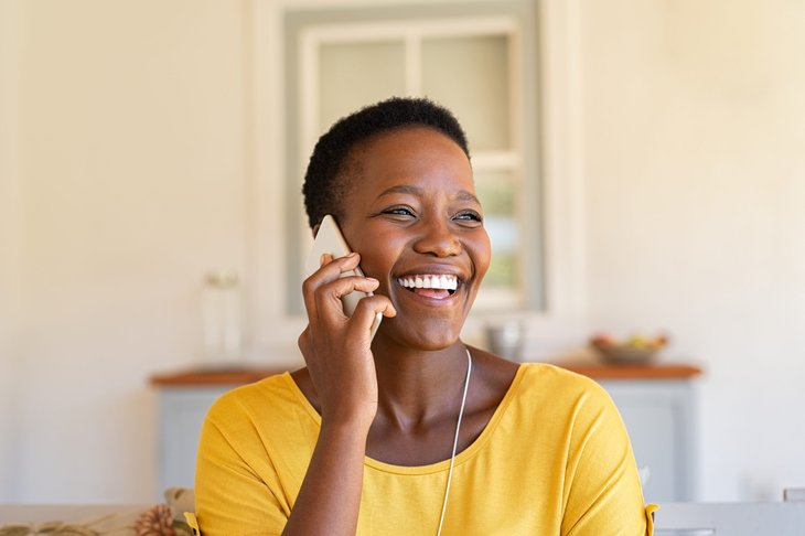 Happy woman on cellphone
