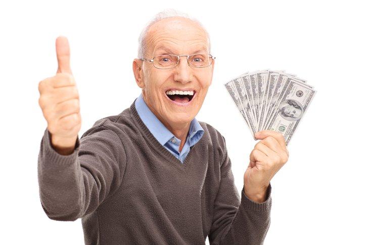 senior man holding money
