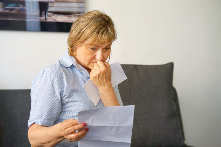 Upset woman reading letter