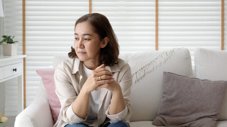 Worried woman on her sofa