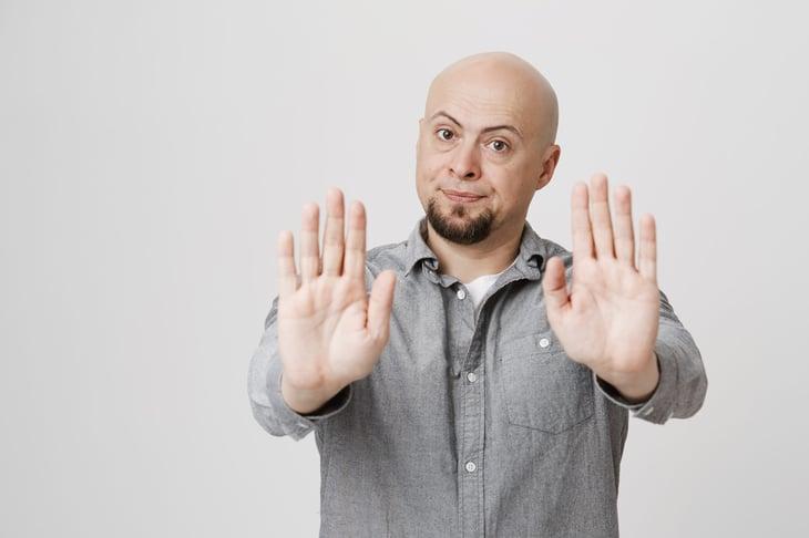 Man signaling people to stay away