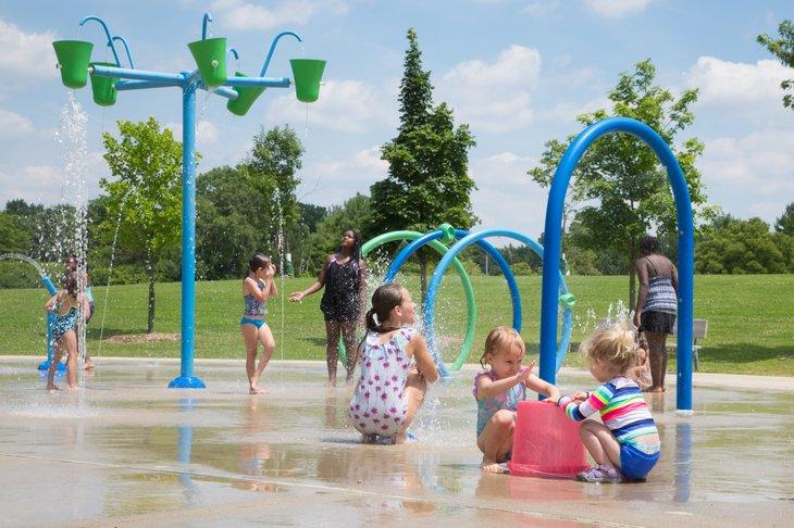 Children on a splash pad in Farmington, Michigan
