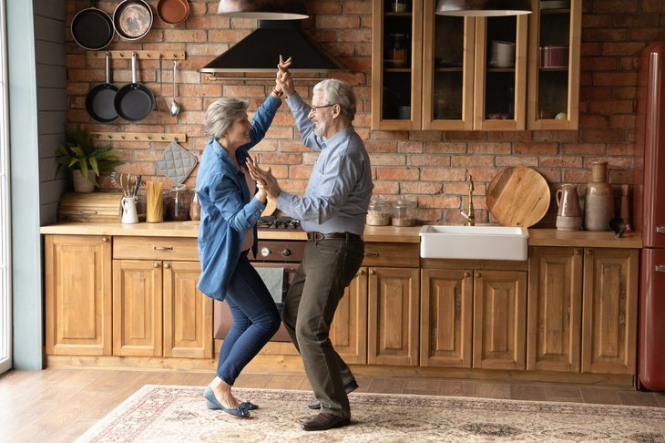 Senior couple dancing in their kitchen