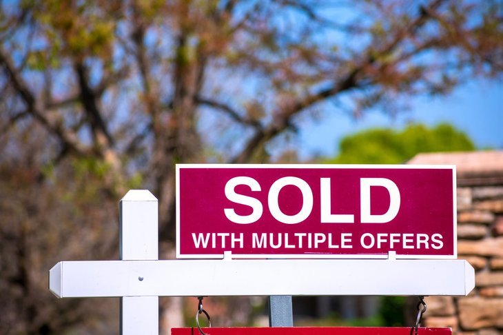 Sold with multiple offers sign