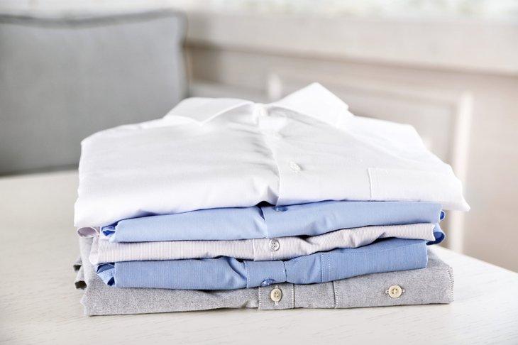 Pile of folded dress shirts