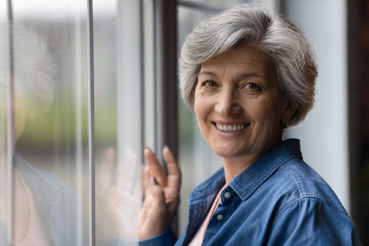 Happy woman thinking about retirement