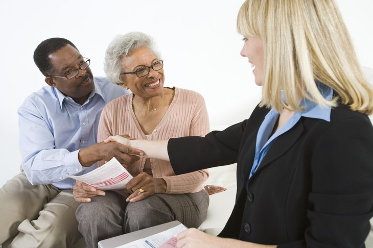 Senior couple with financial adviser
