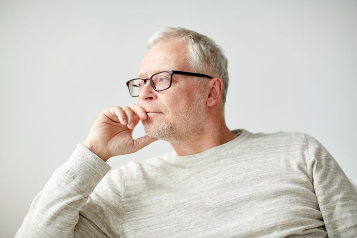 Concerned senior man thinking about taxes and retirement