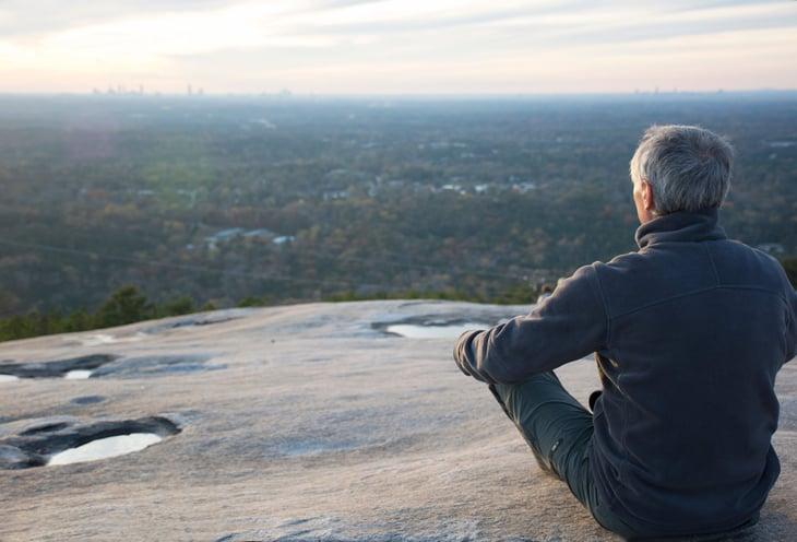 Senior viewing the Atlanta skyline from atop Stone Mountain in Georgia