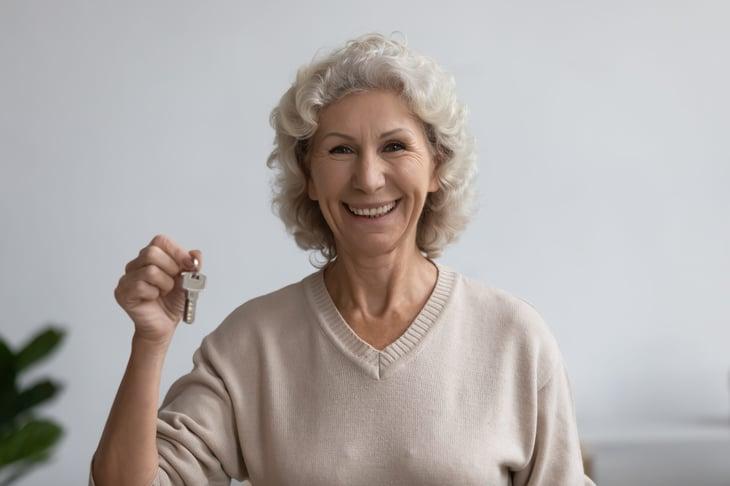 senior woman with house keys