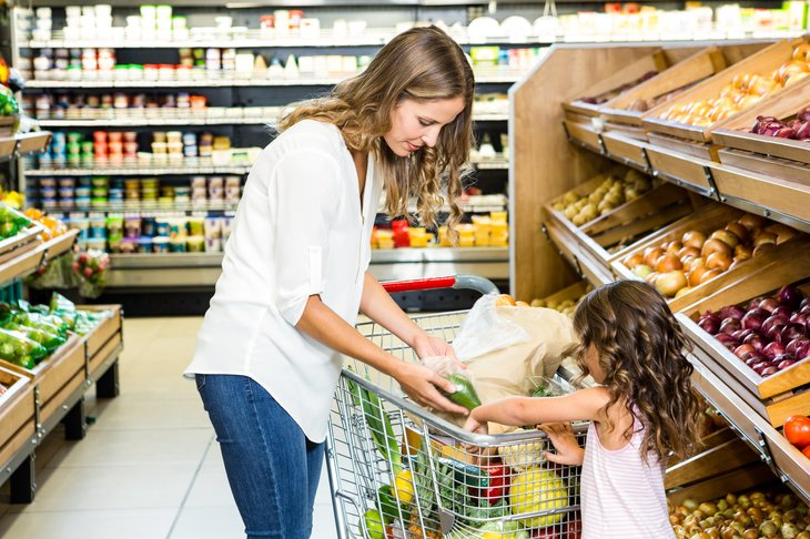 Woman and child in grocery store.