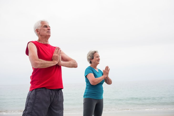 Older couple practicing yoga