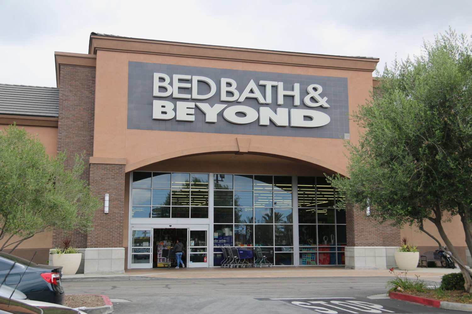 Bed Bath & Beyond said it earned $ million, or 36 cents a share, in the quarter, compared with $ million, or 67 cents a share, in the year-ago period. Revenue was flat at $ billion.